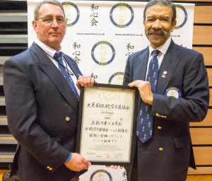 Neville Smith presenting Shihan Christopher Thompson his 9th Dan certificate.